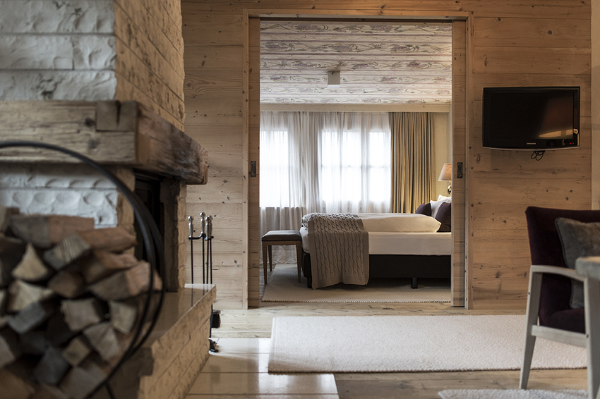 The suite is very spacious and has pine wood panels at Rosa Alpina