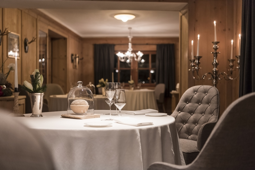 The elegant restaurant room at St Hubertus restaurant in San Cassiano, Italy